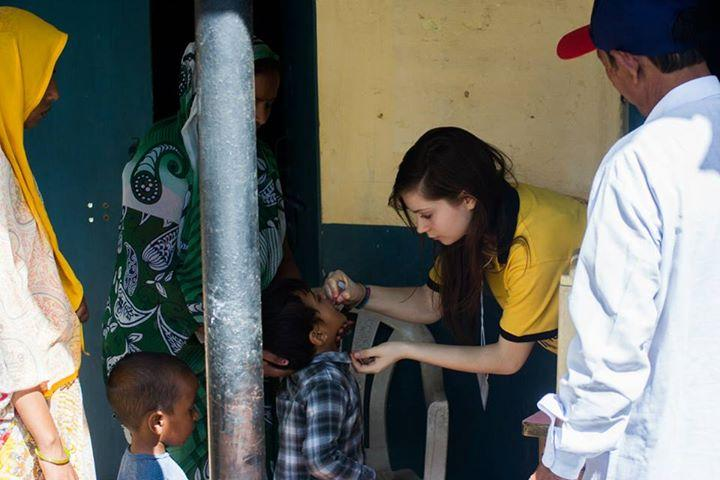 Member of Abingdon's Interact Club (=Junior Rotary) immunising an Indian child against polio on Rotary's 110th birthday. Photo taken from her camera.