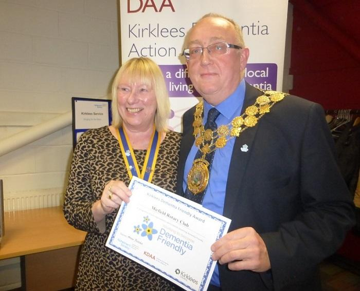 SUE CHARLESWORTH RECEIVING THE AWARD FROM THE MAYOR OF KIRKLEES