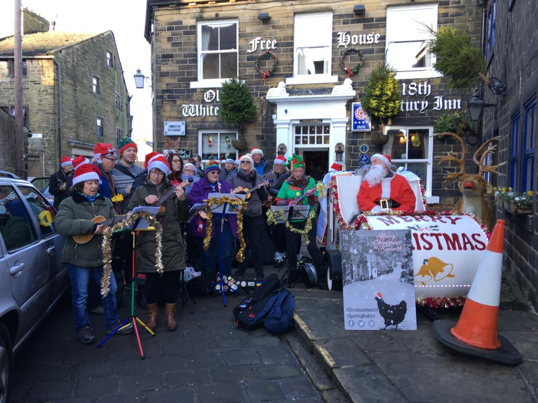 Rotarians with the  Haworth Ukulele group bringing Santa to the Haworth Community as part of the annual Christmas in Haworth weekends