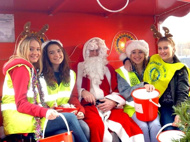 Santa and his helpers out on his sleigh with helpers from Brooksbank School