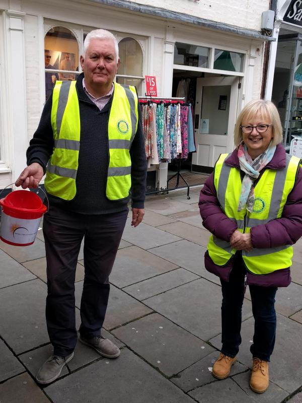 Rotarians Paul Saxby & Kate Heythornthwaite collecting in Melton