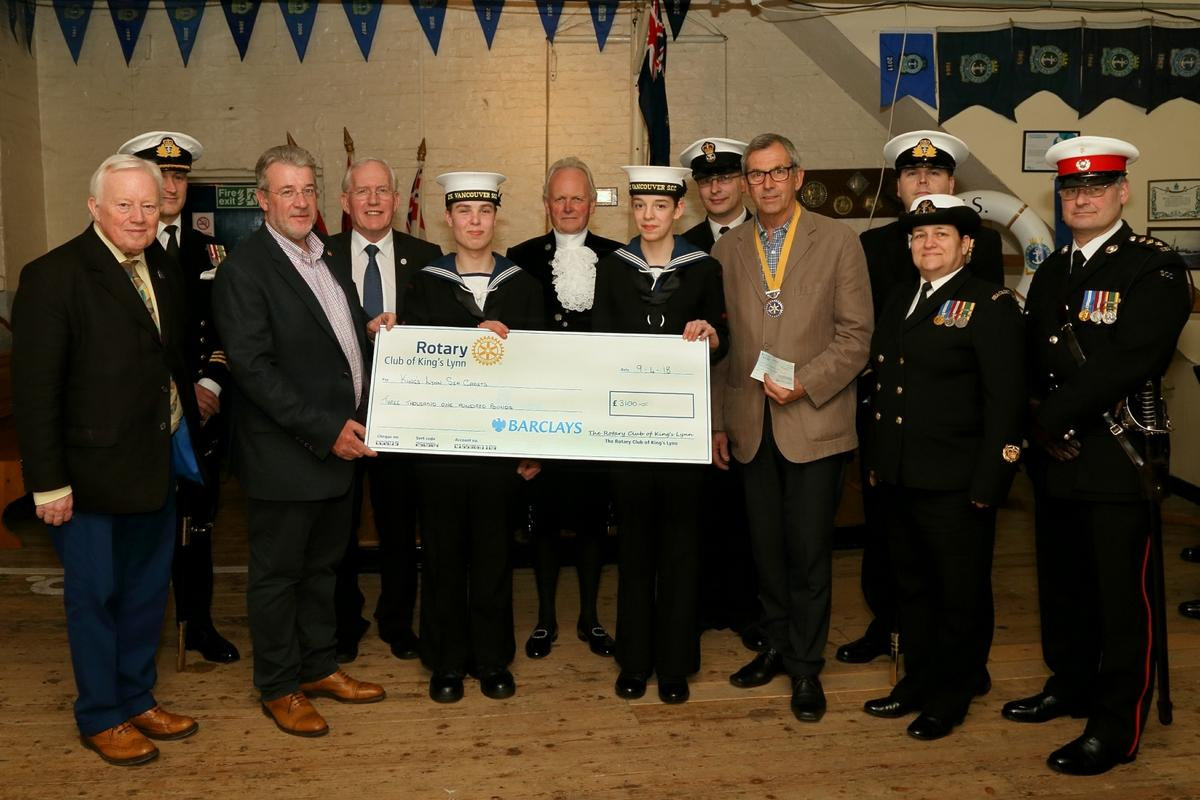 Vice President Pip Rippengill, Community Committee Chairman Steve Roberts and Rotarian Dr Paul Richards, during a major inspection of the Unit by senior Naval officers and the High Sheriff of Norfolk,  Mr Charles Watt. (centre).