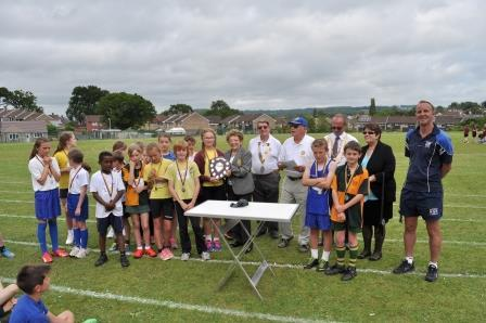 Rotary District Governor Judy Barnard-Jones presents the winners trophy to Redstart School.