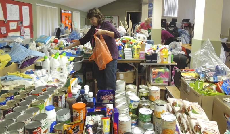 Local Disaster - Three Club member's wives organised and sorted the large amount of clothing, cleaning materials and food handed into Ferriby Village Hall.