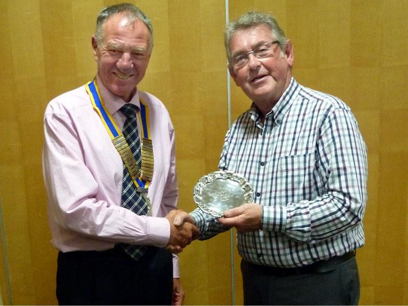 David Landy accepts the Southport Links Golf Trophy from President Geoff Bigg
