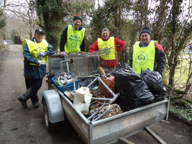 A team of nine members and supporters of Bala and Penllyn Rotary Club turned out for the start of the Spring Clean season and gathered a substantial amount of discarded junk and litter from the footpaths and woods near the river Tryweryn.