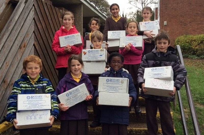 SHOEBOXES FULL OF CHRISTMAS CHEER - St Dominic RC School pupils with some of their shoe boxes