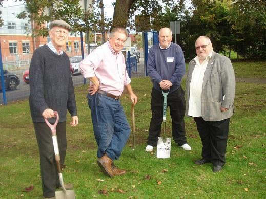 Pupils and Crewe Rotarians having completed planting 1000 purple crocus at Sir William Stanier High School