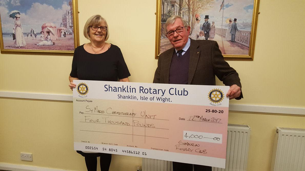 Club President, Steve Knight, presents a cheque for £4,000 to Anne Taylor