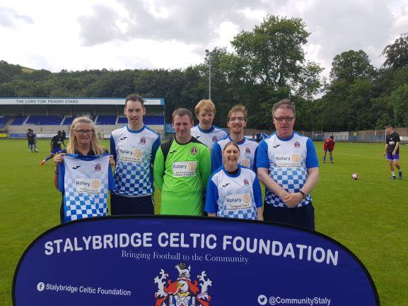 Community Chair Judi Kelly presents Stalybridge Celtic Blues with their new kit.
