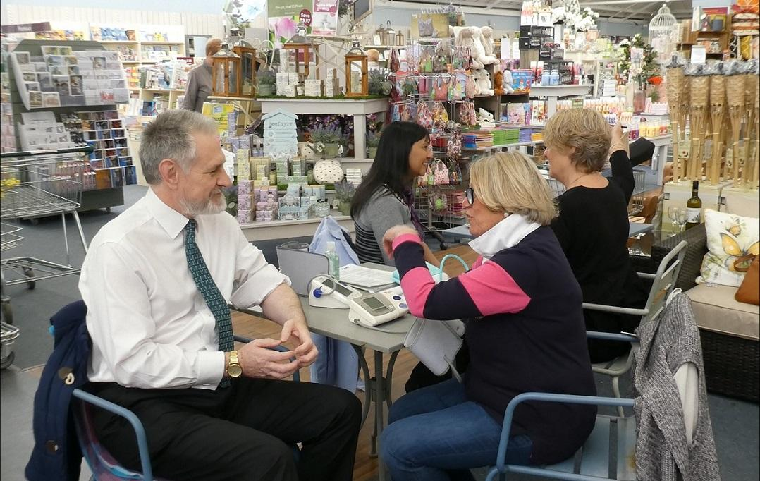 Stroke Awareness Day at Squires Garden Centre - Grace Gibbs,Secretary of TuT Rotary Club taking the blood pressure of the Mayor in 2016