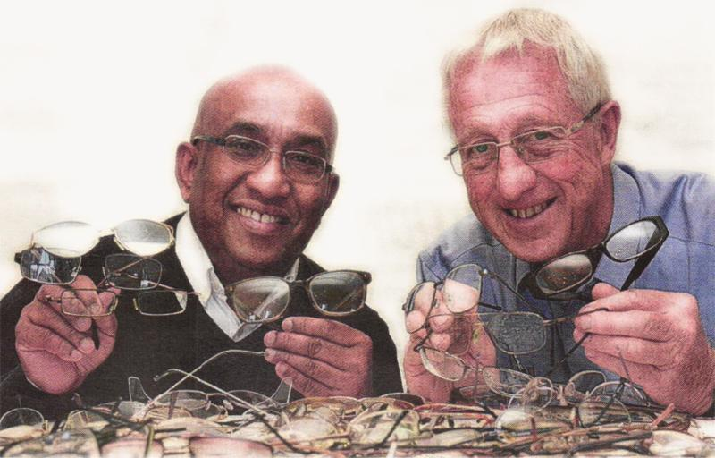 Stroud Rotary members Lakshman Gallage and Jim Hutton with spectacles collected for Sri Lanka (photo courtesy of Stroud Life).