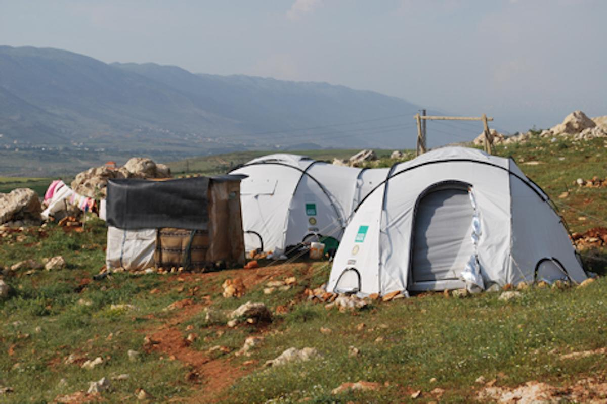<b>Shelterboxes in action</b> - just two of the emergency shelters and supplies sent to over 107,000 families worldwide following disaster since Shelterbox started on 2000