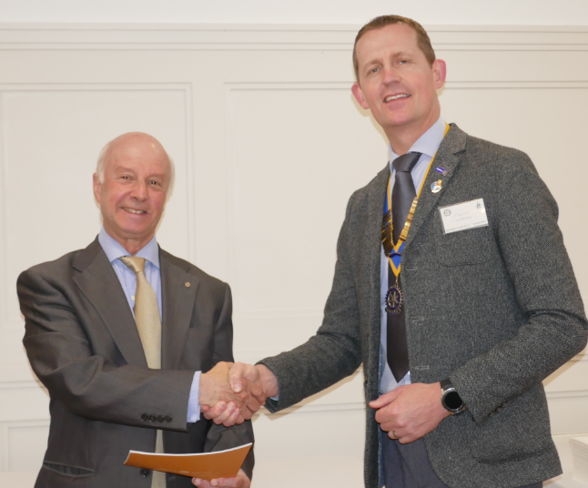 The Rotary Club of Rayleigh Mill welcomes new member Terry Morris - President Martin Stibbards welcomes Terry to the Club
