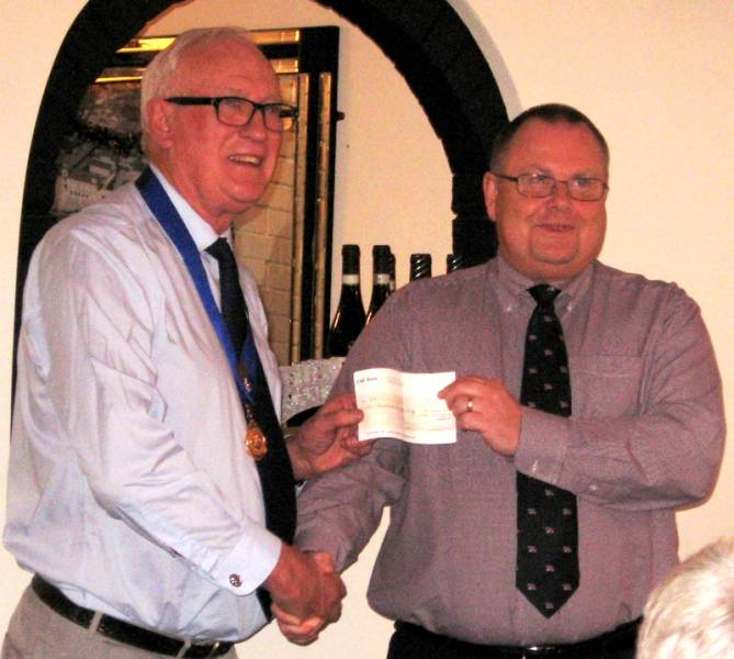 RNLI's Terry Sheppard receives a cheque from PP Alec Banyard