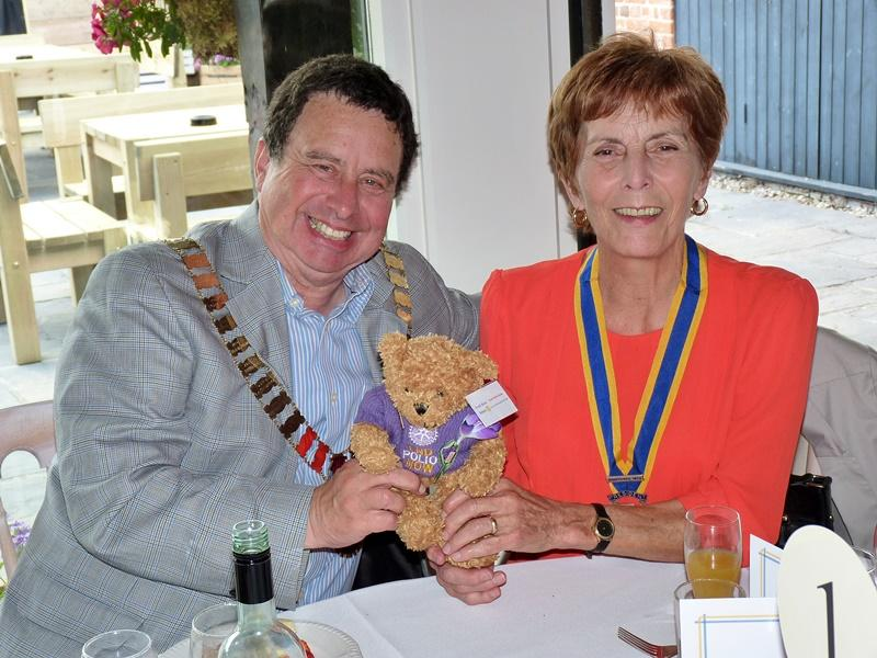 Fred Bear raising awareness and funds to end polio - At the end of the year - with DG Terry Dean and President Brenda
