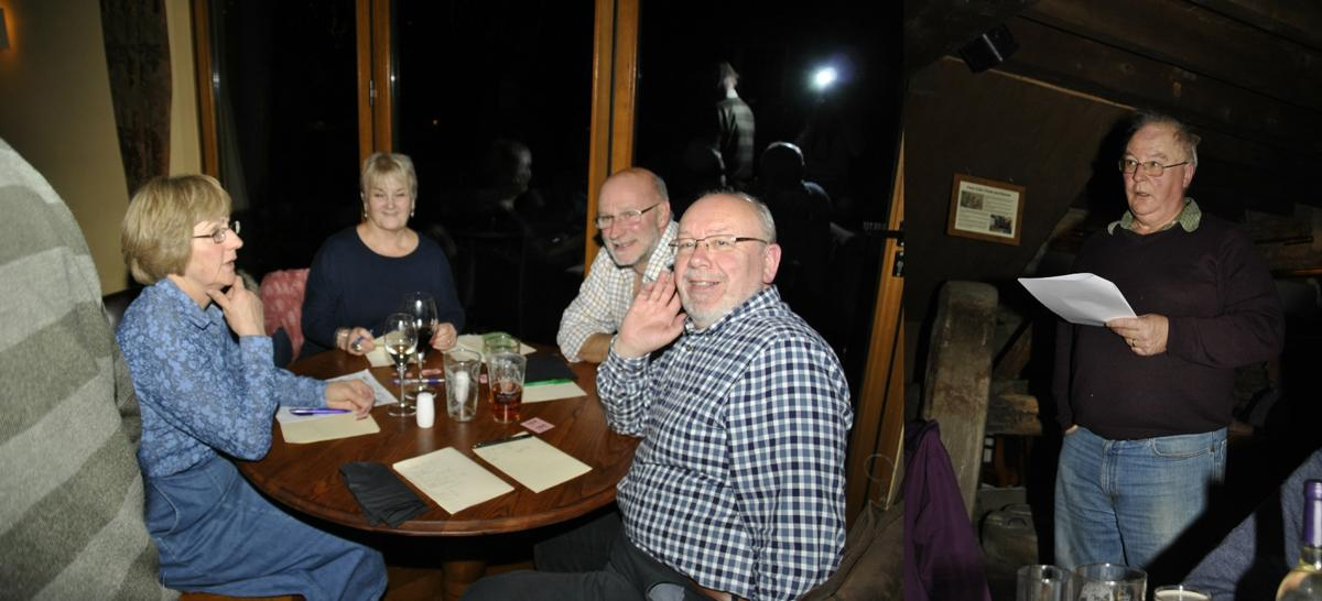 The winning team Marje, Margaret, John, Norman with Quizmaster Paul in full flow