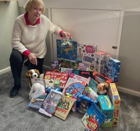 Spreading Christmas Joy in the community. - Rotarian Liz pictured with many of the toys destined for distribution around the area for Christmas.