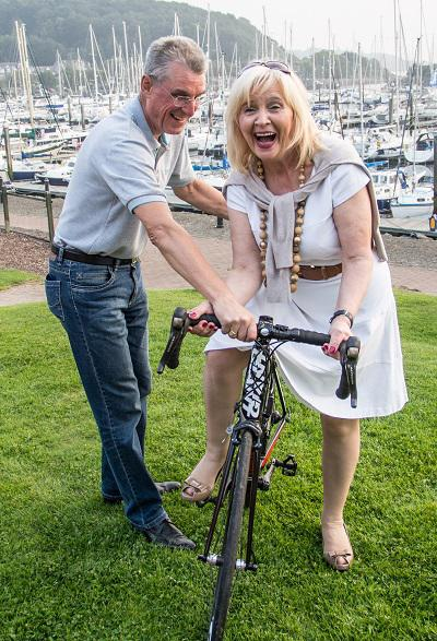 David Attwood's cycle ride  - President Anne gets a cycling lesson from David Attwood.