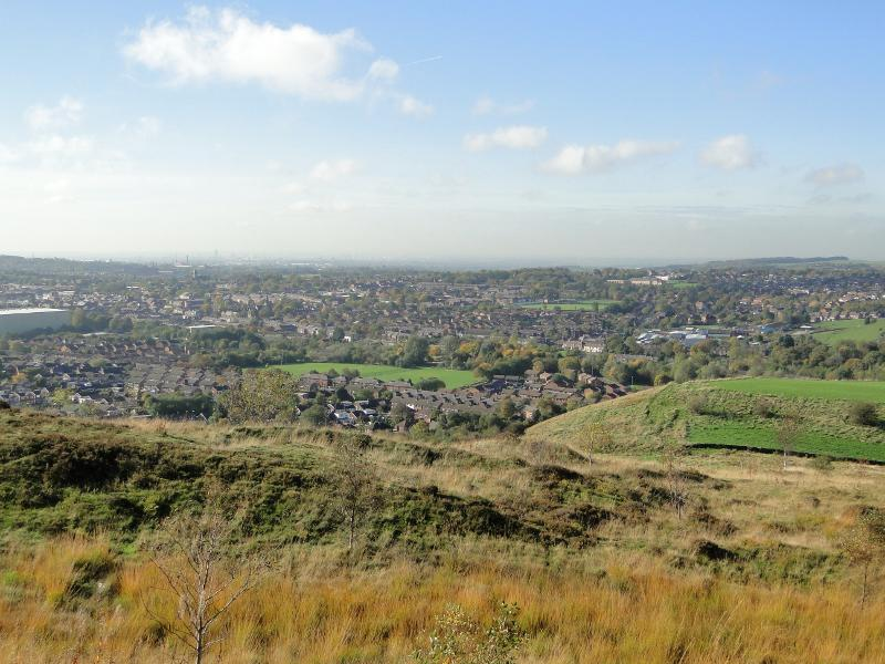 Local Area Information - View of Shaw looking towards Royton, with Manchester in the distance.