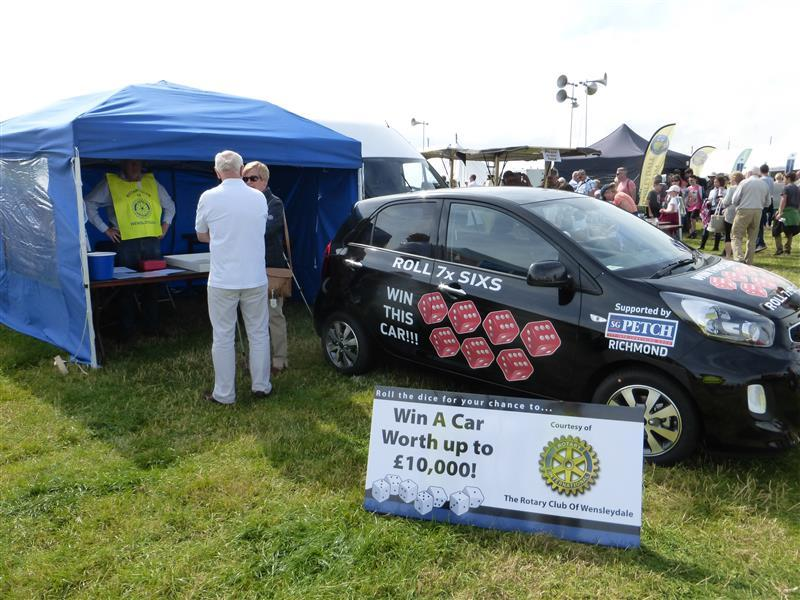 Rotary tent with prize car