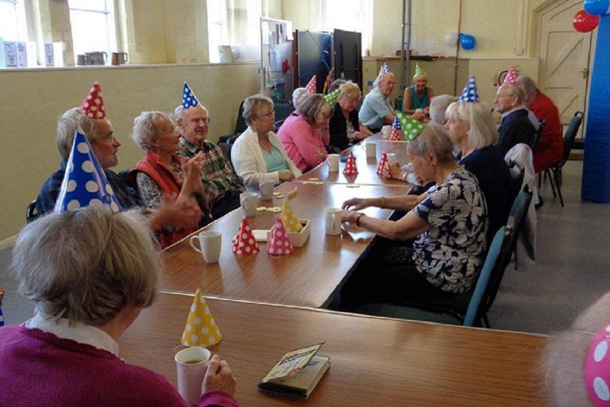 Guests at the Wirksworth Memory Café enjoy their birthday party