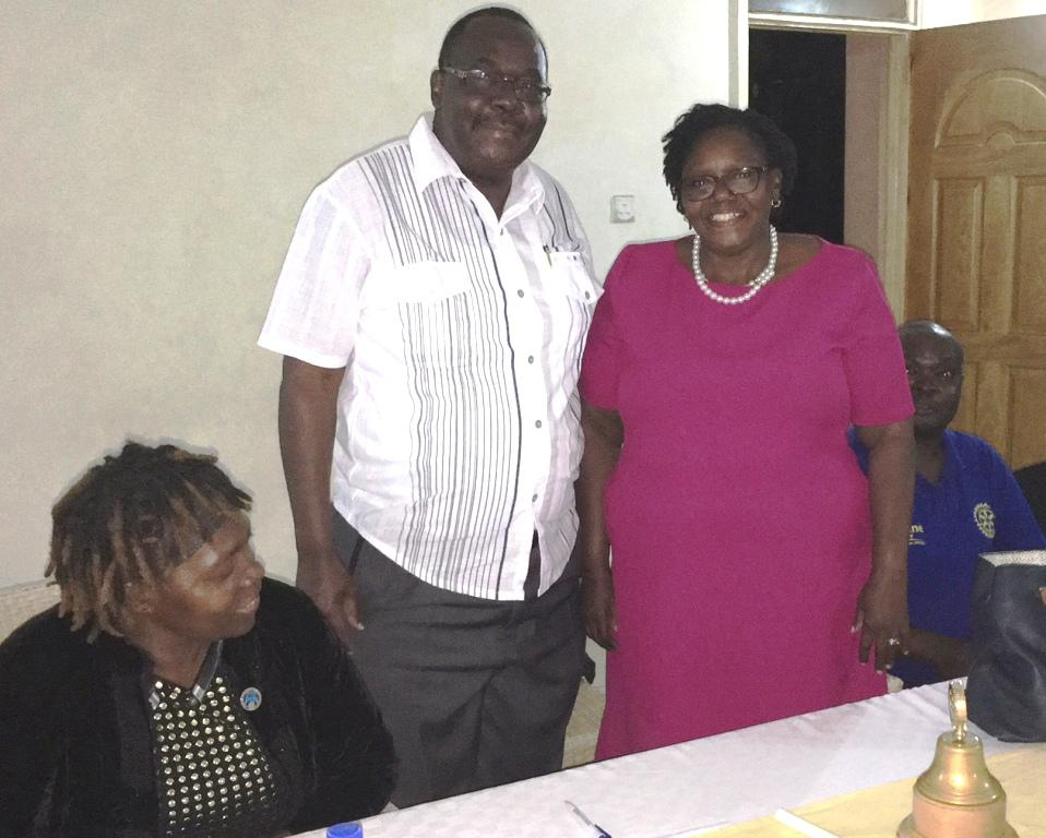 Visits to Other Rotary Clubs - President Juvenal Shiundu meets with Mrs Esther Mudy who is the President of the Rotary Club of Kakamega in Kenya.