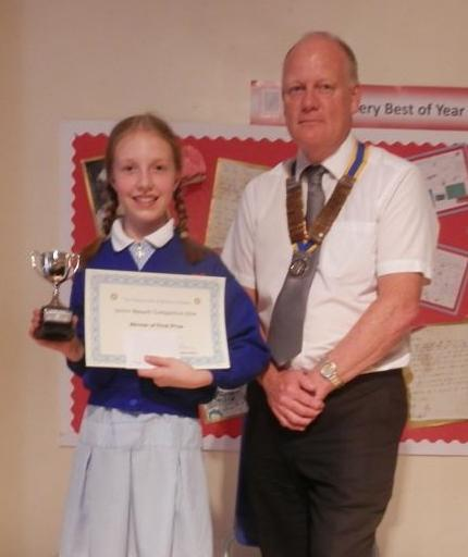 President Stephen Griffiths presents the Winners Trophy to Alice Higginbottom
