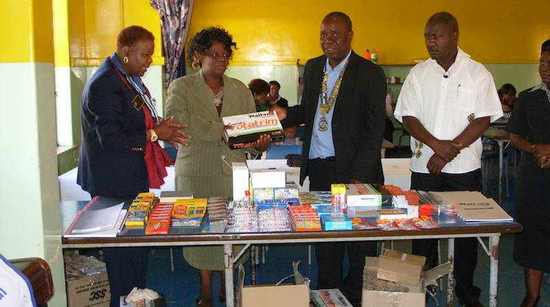 The goods being handed over to the school in the presence of Rotary District 9210 Governor Stella Dongo (extreme left)