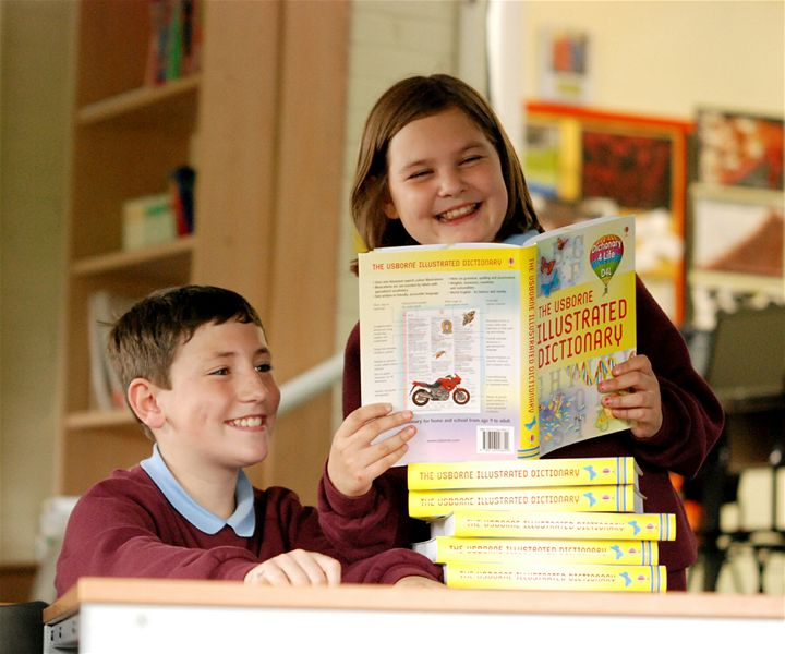 Olver Johnston and Georgina Yates at St Joseph's Roman Cathlic Primary School Darwen, were delighted with the Pictorial Dictionaries presented to the school by the Rotary Club of Darwen