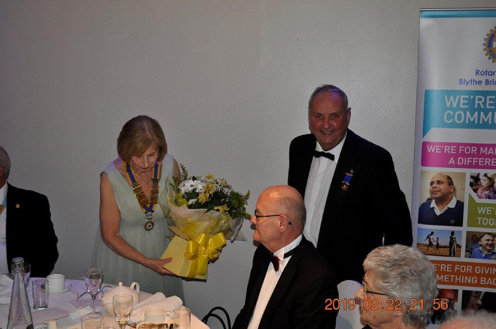 2019 - President's Party Night - President Enid receiving flowers in recognition of  her amazing year of office.