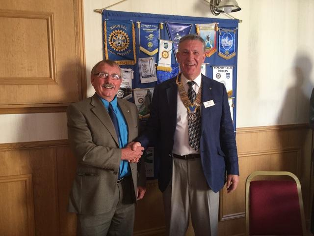 Retiring President Peter hands over the chain of office to Albert Donald