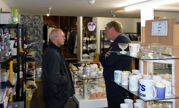 Archbishop discusses the shop with Rotarian Alan Rainsley