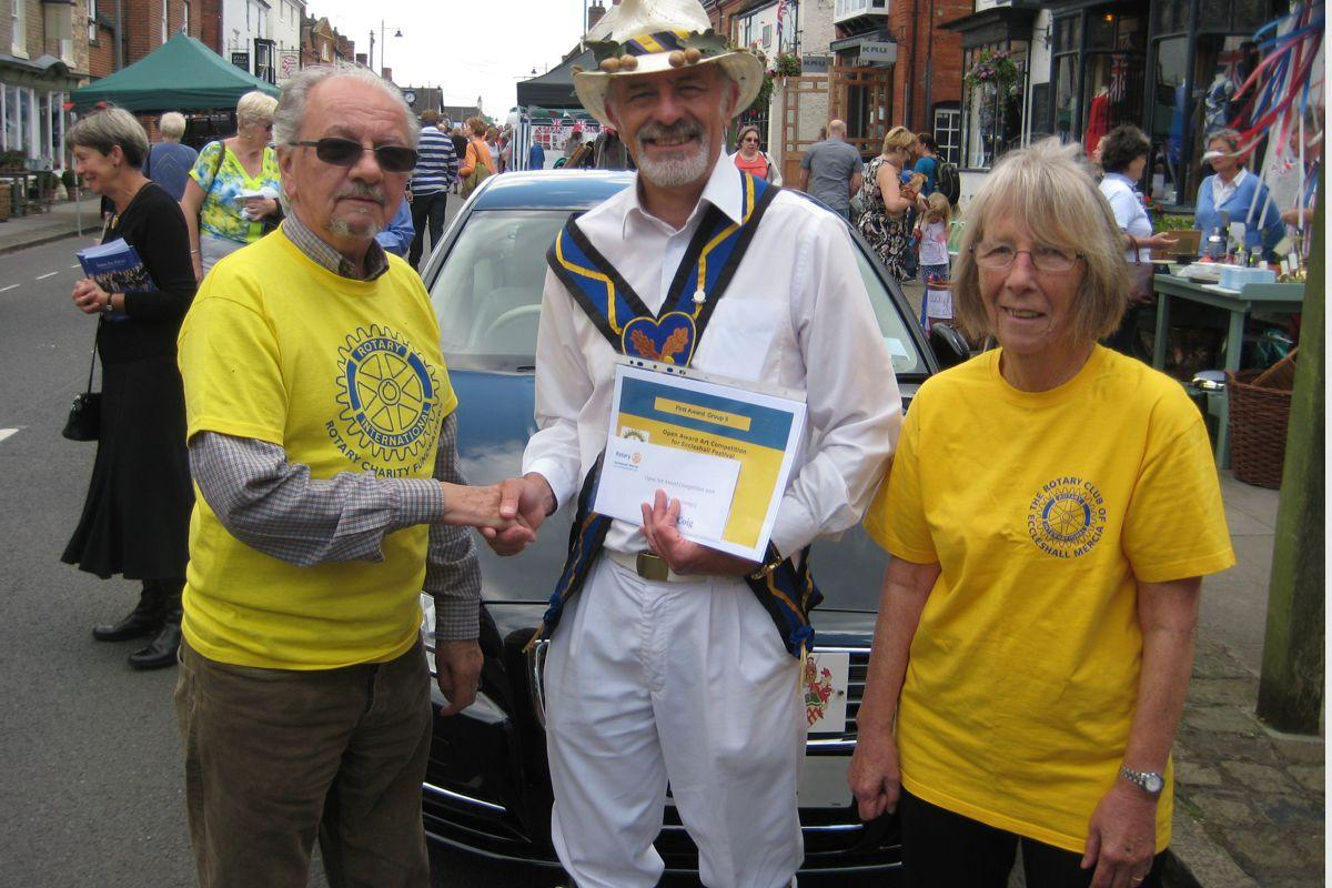 Eccleshall Festival 2016 Open Art Awards Competition results - Club President Alex Cairns-Lawrence & organiser Hilary Ball with a competition winner