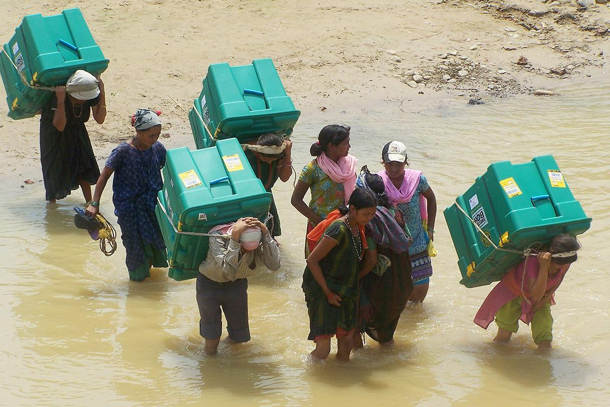 Carrying shelterboxes through a flood