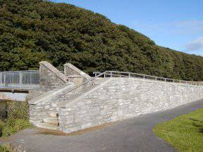 The ramps and steps to the cemetery bridge over the Thurso River.