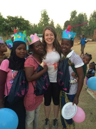 Bishop's Offely girl tells us how it is in parts of rural Africa - Claire with villagers in rural Malawi