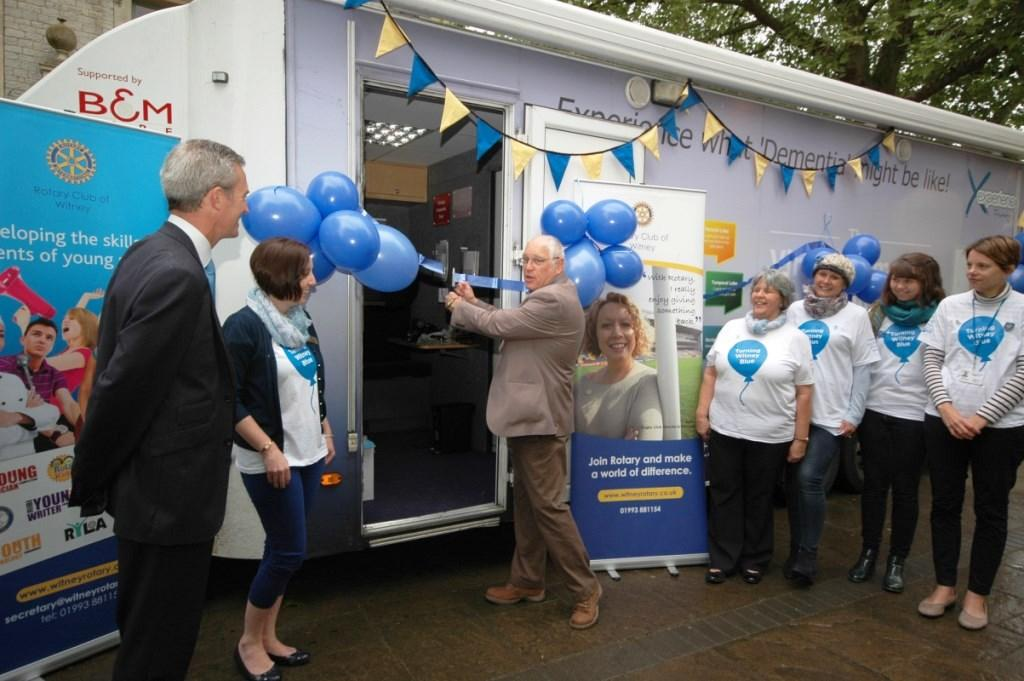 Rotary President Steve Holborough opens the Mobile Dementia Exhibition  in Witney Market Square