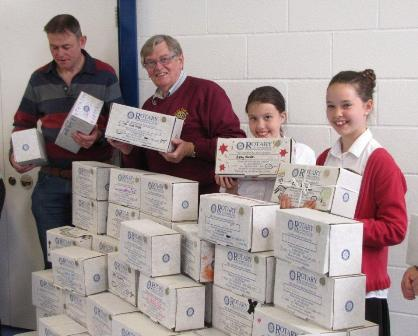 Rotarians with pupils from Falklands Primary School, collecting Shoeboxes