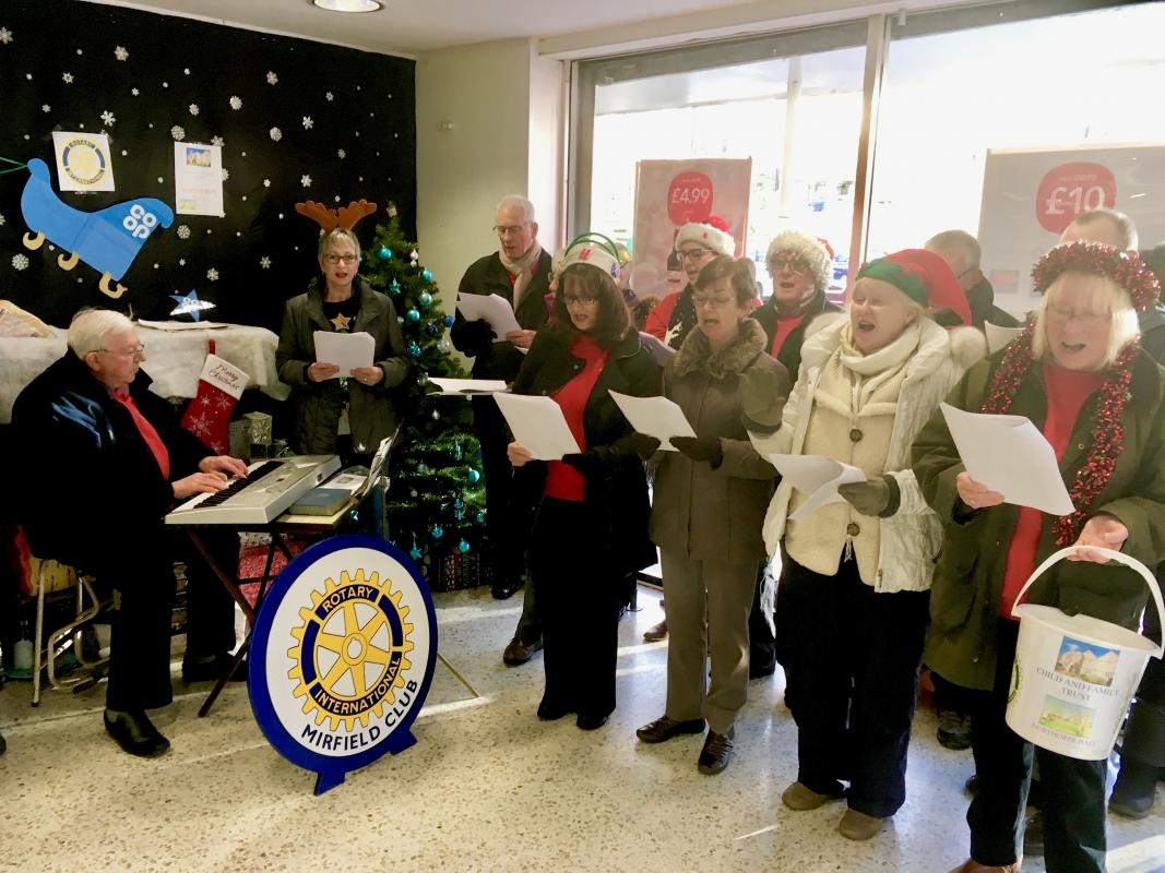 OUR FUND RAISING EFFORTS - WHY? - Carol Singing at Mirfield Co-op December 2017