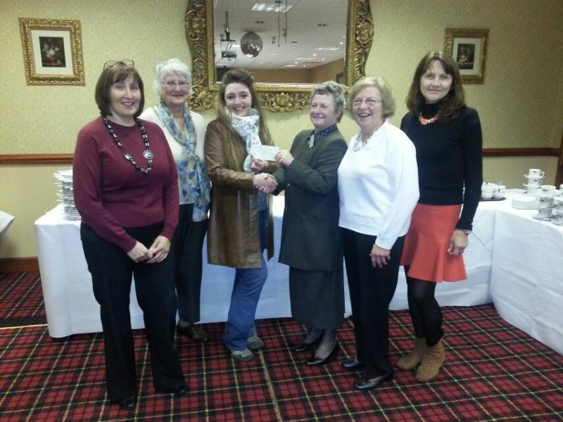 President Barabara handing over the cheque to the Hospice supporters