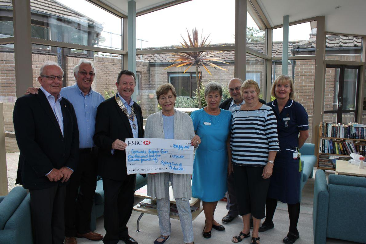 President George presenting cheque for £1500 to Cornwall Hospice Care
