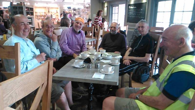 The TuT cyclists in typical fashion! - TuT Rotary Cycling group putting the world to rights at a coffee stop