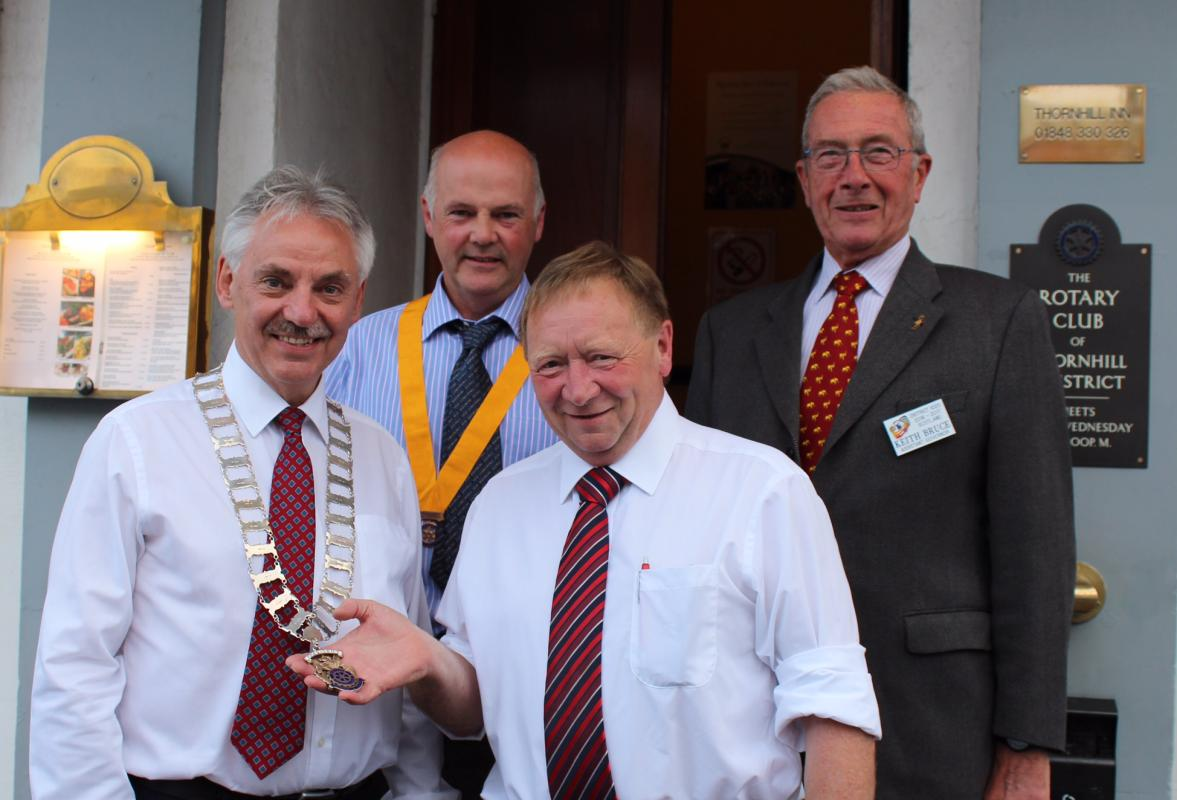 Picture shows President Ian (L) with outgoing President Gordon Steele. Looking on are Vice-President Gavin Kilgour and Assistant Governor Keith Bruce of the Rotary Club of Kirkcudbright.