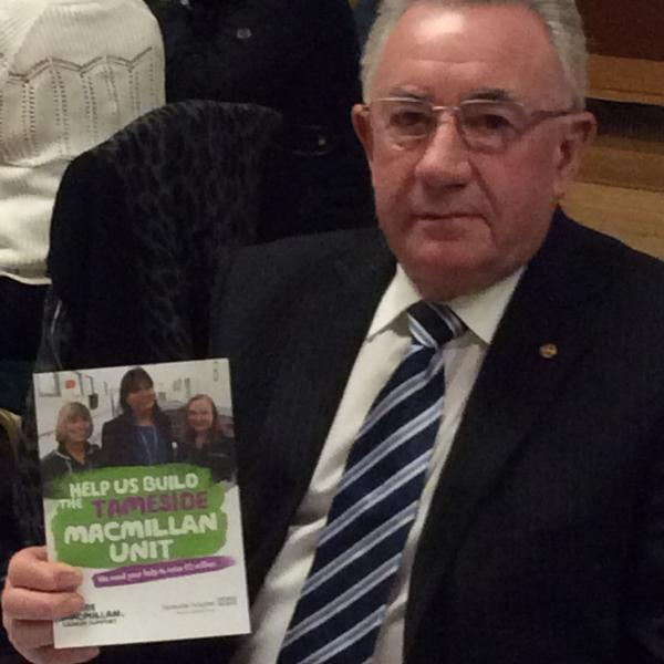 Rtn Derek Baines with leaflet promoting Tameside MacMillan Unit