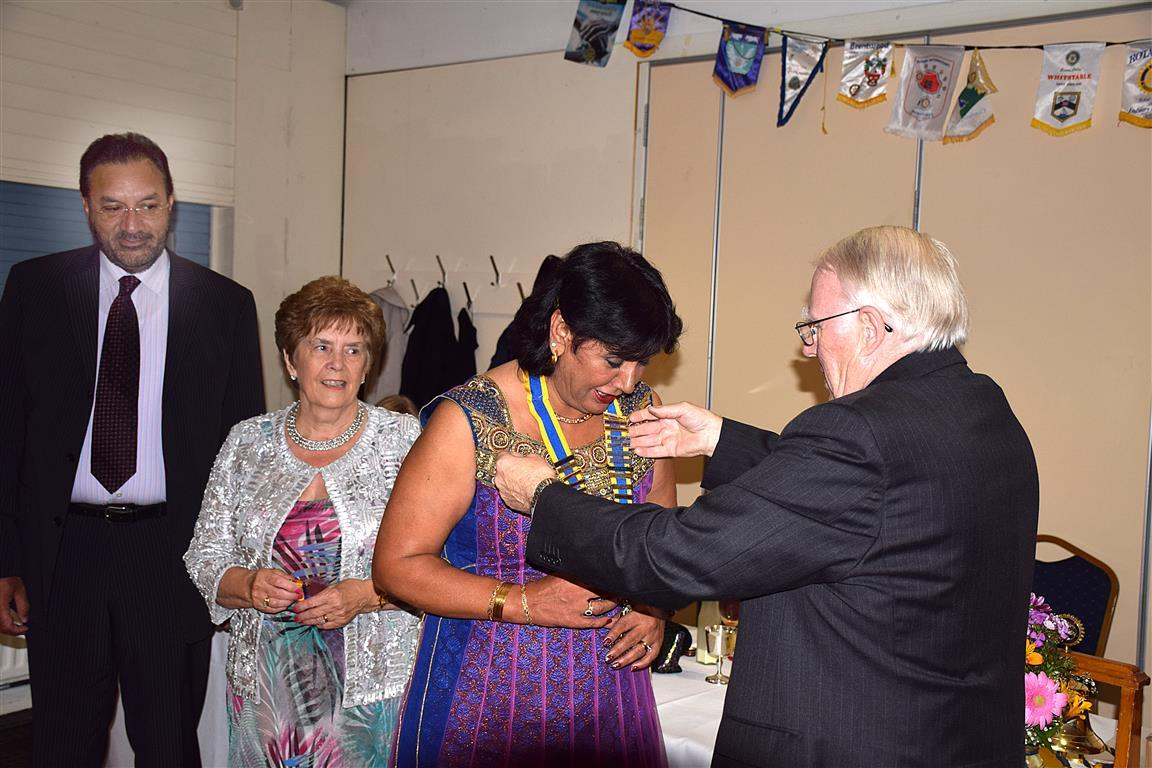 Club Hand Over - June 2016 - President Jaz Dhaliwal receives her chain of office from IPP Don Simpson.