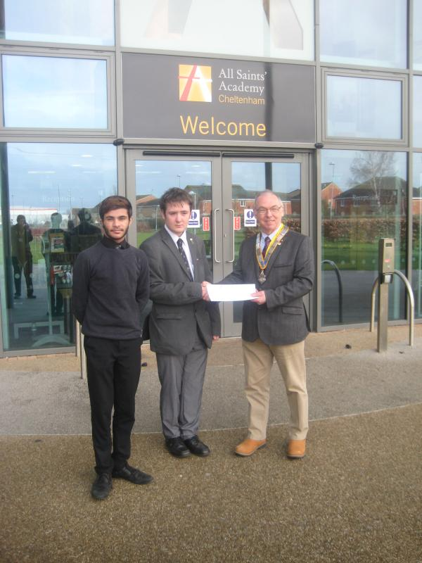 All Saints Academy Small Grants - President Simon presenting a cheque to an All Saints student.