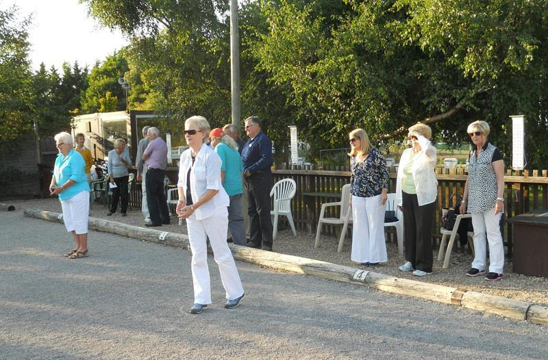 Petanque Evening - Players playing Pétanque in the summer