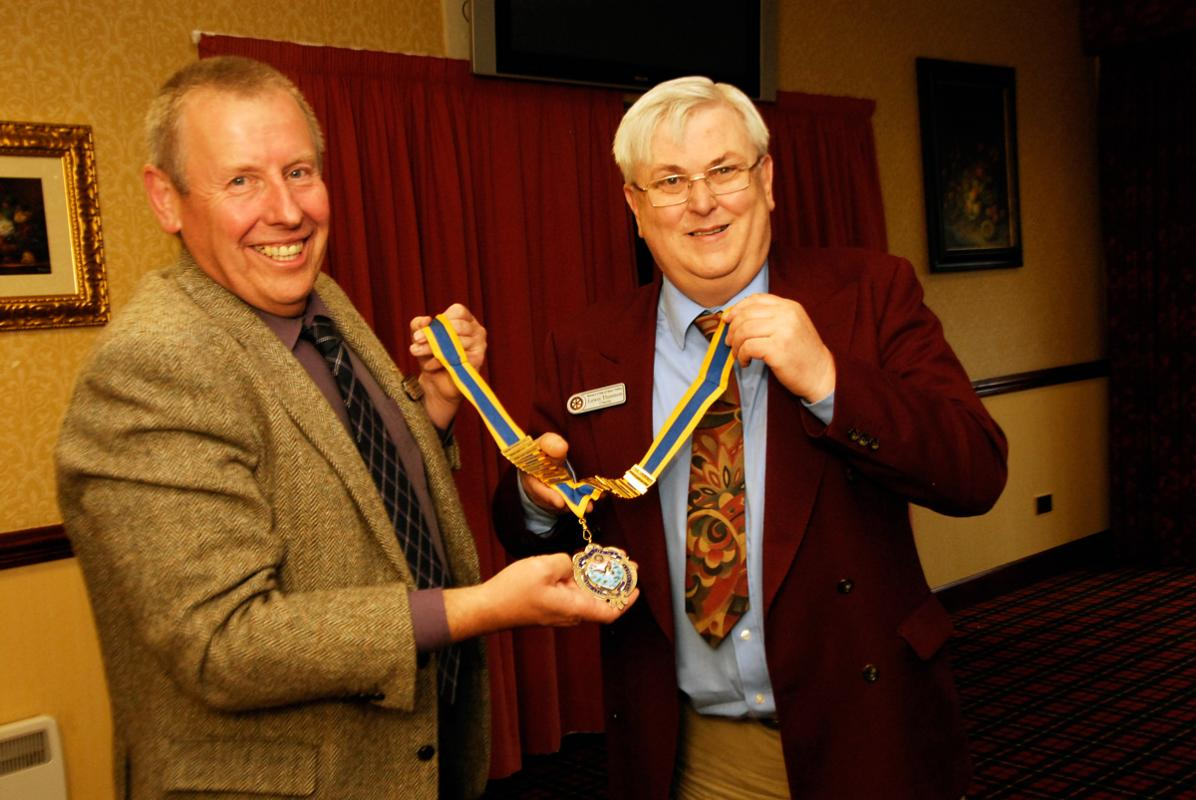 President Stephen Wood receives his Chain of Office from Past President Lewis Thomson