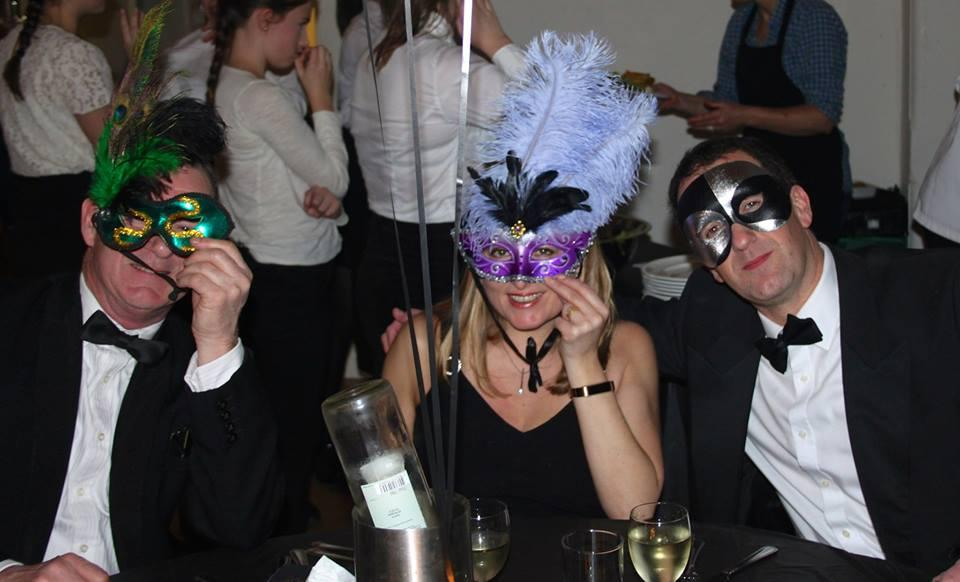 Party-goers revel in the glitzy evening at the Club's Charity Masquarade Ball.